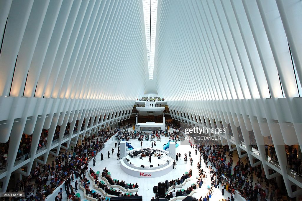 People gather Inside the Oculos at the World Trade Center during the grand opening of Westfield's shopping complex on August 16 2016 in New York /...