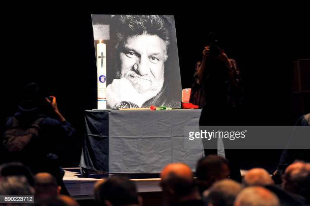 People gather near a portrait of late Bosnian Croat war criminal Slobodan Praljak who commited suicide by drinking poison in front of UN judges...