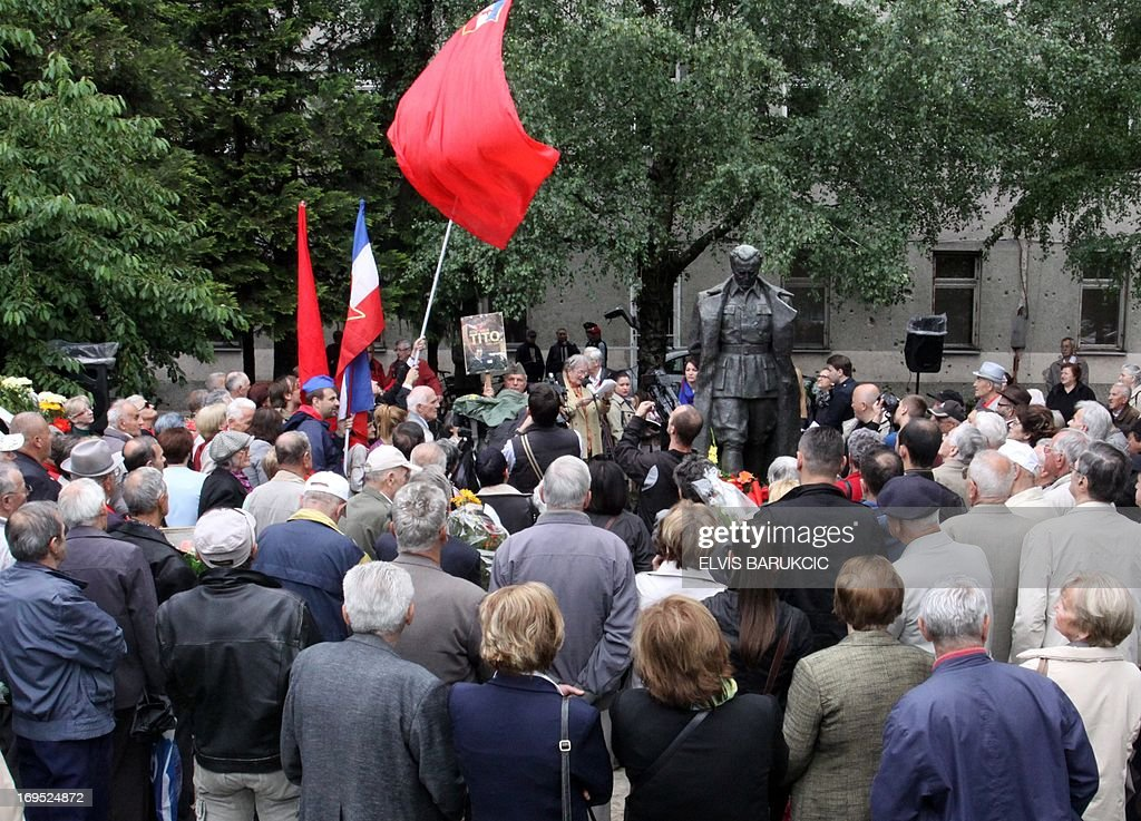 People gather near the statue of ex-Yugoslav communist leader Josip Broz Tito as they comemorate his birthday in Sarajevo, on May 25, 2013. As the last Yugoslav king Petar II Karadjordjevic was reburied in Serbia on May 26, hundreds of supporters of his post-World War II political rival, communist leader Josip Broz Tito, marked the 121st anniversary of his birthday throughout his former homeland. Josip Broz was born on May 25, 1892 in Croatia. He later became Yugoslav communist party leader and a lifetime president of Yugoslavia. He died on May 4, 1980 and after his death Yugoslavia fell apart and the socialist ideas mostly vanished in the region torn apart by nationalist policies led by his successors in all ex-Yugoslav republics.