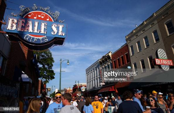 People gather on Beale Street before Game Three of the Western Conference Finals of the 2013 NBA Playoffs at the FedExForum between the San Antonio...