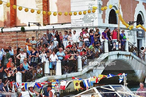 People gather on bridges during the Redentore Celebrations on July 14 2012 in Venice Italy Redentore is one of the most loved celebrations by...