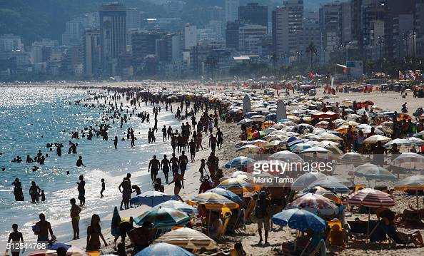 People gather on Ipanema beach a landmark tourist destination in Rio on February 26 2016 in Rio de Janeiro Brazil The Zika virus outbreak which may...