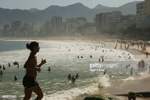 People gather on Ipanema beach located outside Guanabara Bay on August 3 2015 in Rio de Janeiro Brazil The Rio government promised to clean 80...
