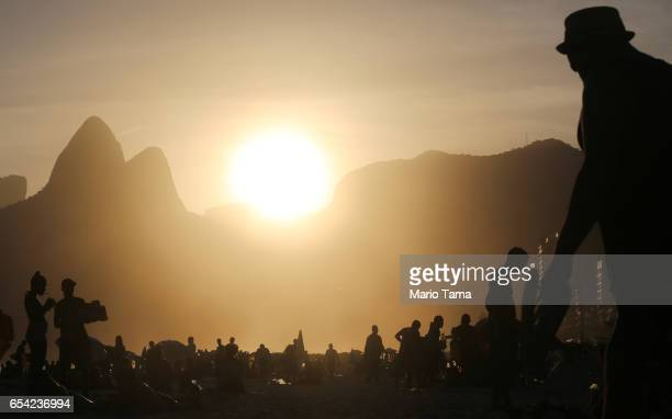 People gather on Ipanema beach on March 16 2017 in Rio de Janeiro Brazil According to the Urban Climate Change Research Network Rio's average...