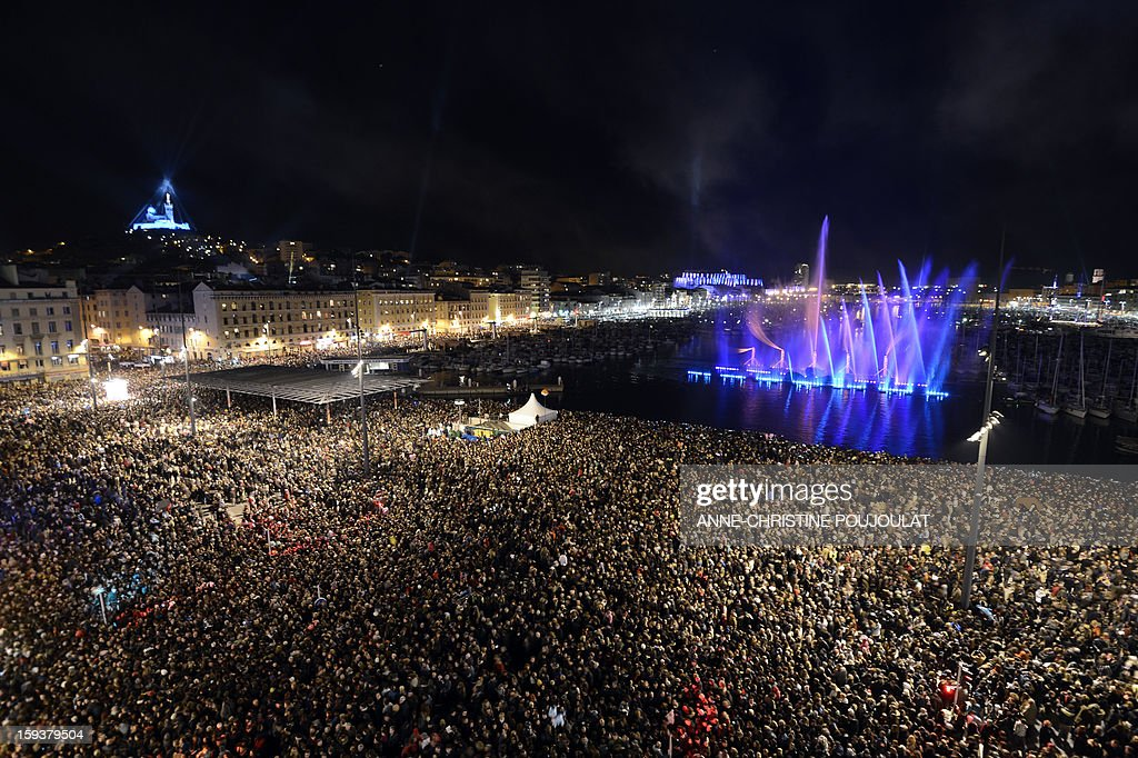 People gather on January 12, 2013 at the Vieux-Port harbour in Marseille, southern France, to attend the opening festivities marking Marseille as the 2013 European Capital of Culture.