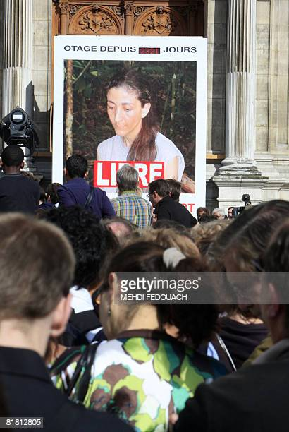 People gather on July 3 2008 in front of the Paris' city hall to celebrate the release of FrenchColombian hostage Ingrid Betancourt who was rescued...