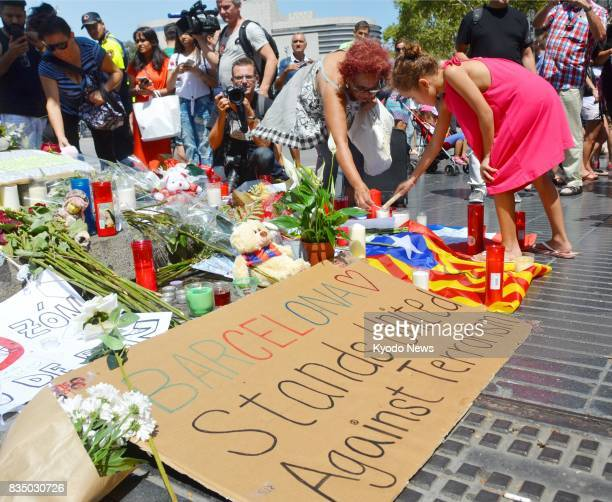 People gather on La Rambla street in Barcelona Spain on Aug 18 to mourn the victims of the terrorist attack ==Kyodo