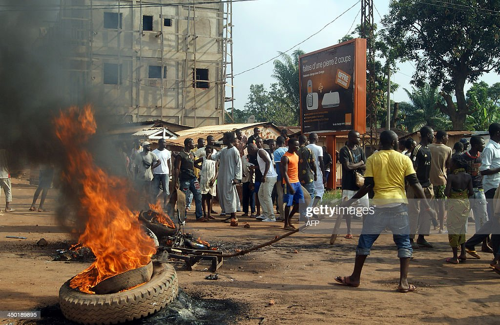 People gather on November 17, 2013 at the Sica-Benzvi square in Bangui as unrest erupt after the assassination of a magistrate the day before.