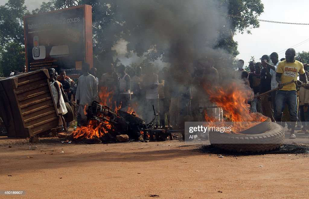 People gather on November 17, 2013 at the Sica-Benzvi square in Bangui as unrest erupt after the assassination of a magistrate the day before. AFP PHOTO / PACOME PABANDJI