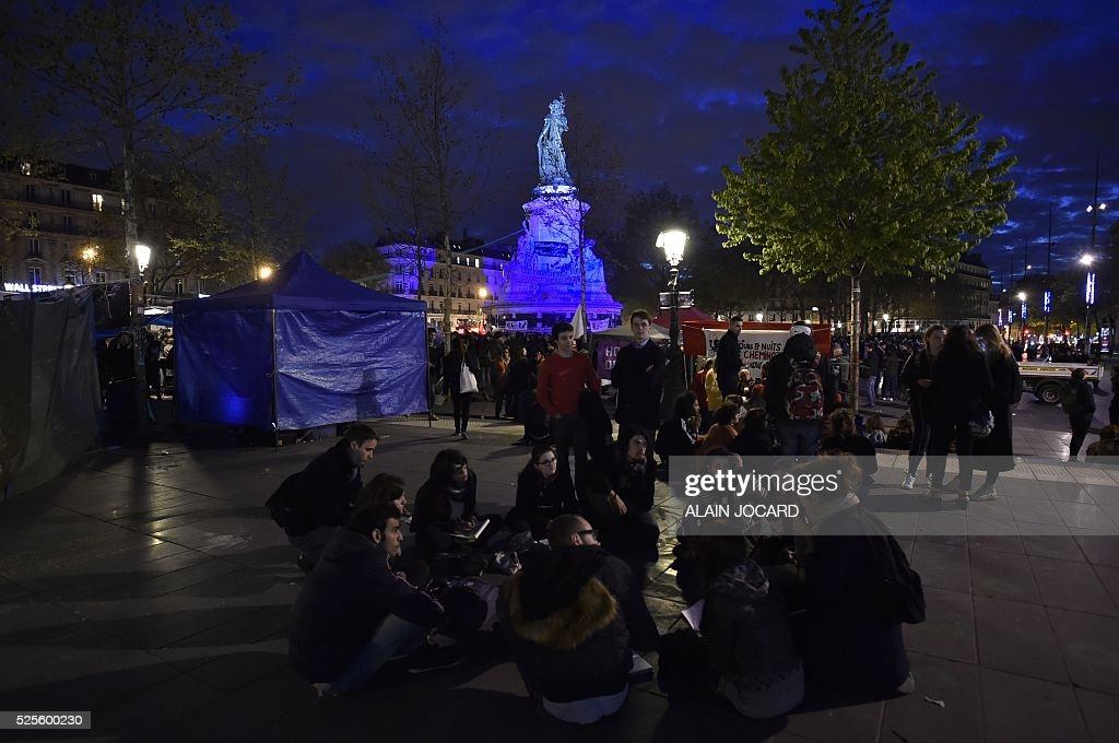 People gather on Place de la Republique during the Nuit Debout, or 'Up All Night' movement on April 28, 2016 in Paris. The 'Nuit Debout' demonstrations began on March 31 in opposition to the government's proposed labour reforms.