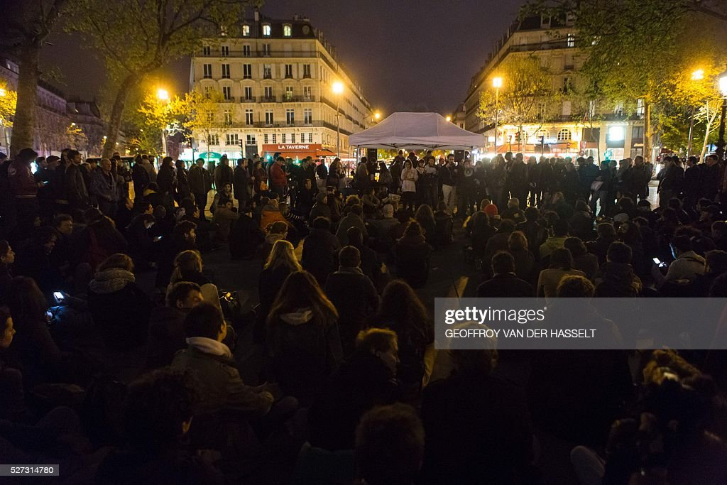 People gather on Place de la Republique in Paris on May 2, 2016, as part of the 'Nuit debout' movement. A wave of protests over planned labour reforms inspired a new youth movement dubbed 'Nuit Debout' (Up All Night) that kicked off on March 31. It has since embraced a range of grievances, spreading from Paris to several other cities. / AFP / Geoffroy Van der Hasselt