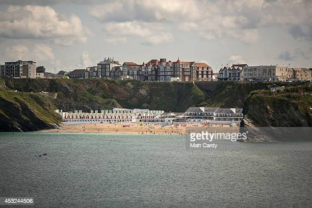 People gather on the beach as the town of Newquay prepares to host the Boardmasters surf and music festival on August 5 2014 in Cornwall England...
