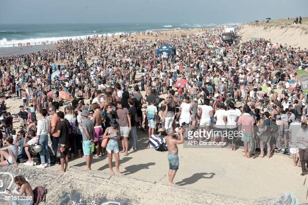 People gather on the beach during the final of the French stage of the World Surfing Championship 2017 Quiksilver Pro France in Hossegor on October...