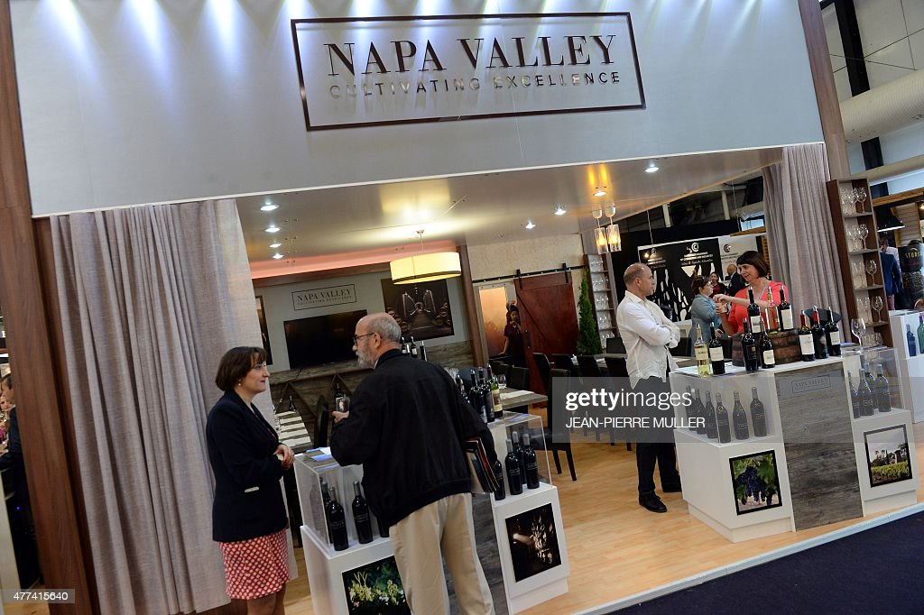 People gather on the Napa Valley stand of the Vinexpo, the ...