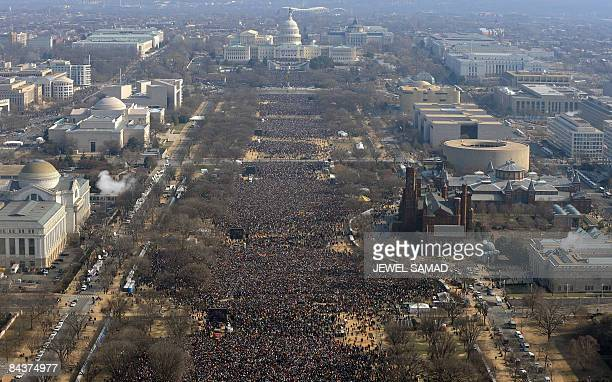 People gather on the National Mall during the inaugural ceremony for Barack Obama as 44th US president at the US Capitol in Washington on January 20...