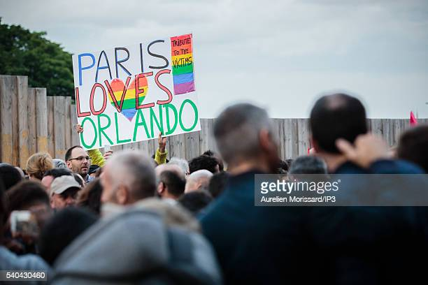 People gather on the Place du Trocadero to show their support after the worst mass shooing in United States history on June 13 2016 in Paris France...