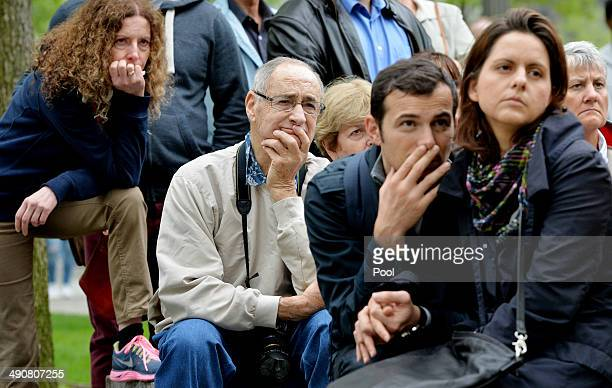 People gather on the plaza of the National September 11 Memorial to watch the telecast of the dedication ceremony for the museum at ground zero May...
