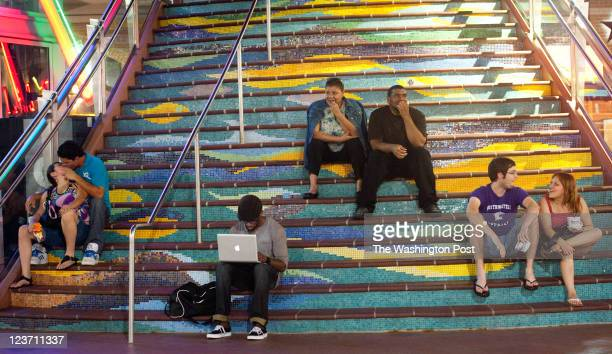 People gather on the stairs on Ellsworth Drive Montgomery county is currently debating whether to have a curfew Downtown Silver Spring is one of the...