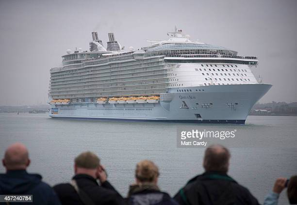 People gather on the waterfront to watch the world's largest cruise ship 'Oasis of the Seas' as she arrives in Southampton Water on October 15 2014...