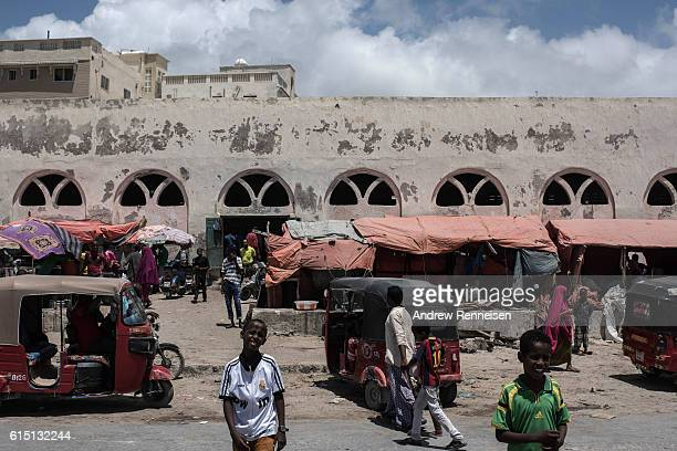 People gather outside a fish market on October 13 2016 in Mogadishu Somalia Somalia is on the brink of its first parliamentary elections since 1984...