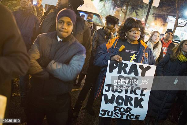 People gather outside Chicago police headquarters for a prayer vigil and demonstration to protest the death and alleged coverup of Laquan McDonald on...