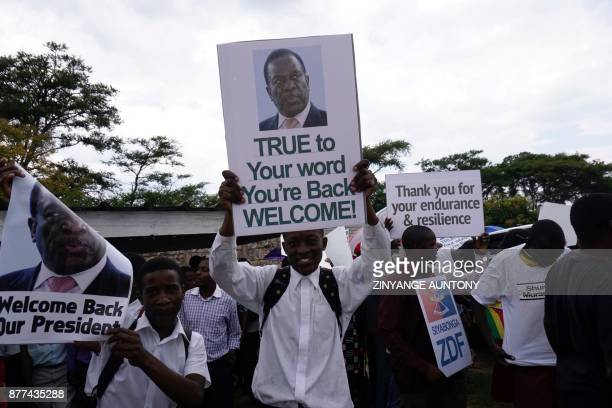 TOPSHOT People gather outside Harare's airport to welcome former Zimbabwean vicepresident Emmerson Mnangagwa on November 22 2017 in Harare Mnangagwa...
