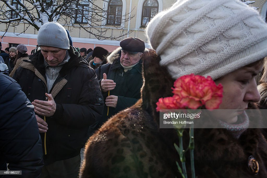 People gather outside Mikhailovsky Cathedral during a memorial service for Mikhail Zhiznevsky, 25, an anti-government protester who was killed in clashes with police on January 26, 2014 in Kiev, Ukraine. After two months of primarily peaceful anti-government protests in the city center, new laws meant to end the protest movement have sparked violent clashes in recent days.