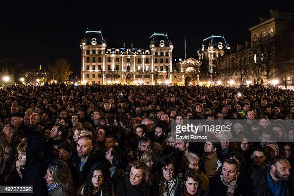 People gather outside of Notre Dame Cathedral ahead of a ceremony to the victims of the Friday's terrorist attacks on November 15 2015 in Paris...