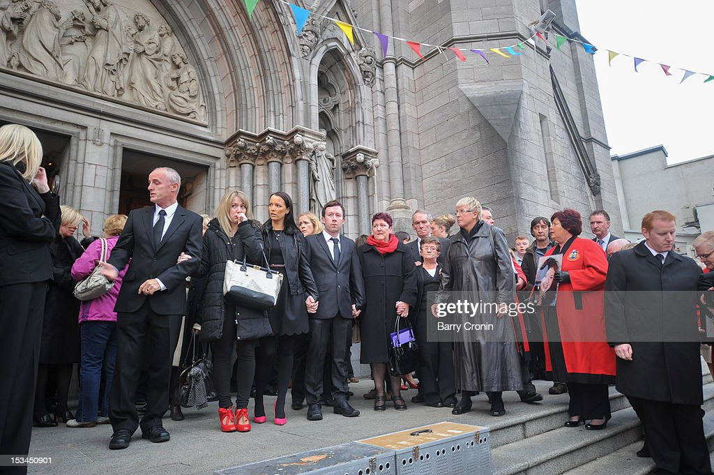 People gather outside St. Peter's Church, where a Memorial Service for murdered journalist Jill Meagher is taking place, on October 5, 2012 in Drogheda, Ireland. Mrs Meagher, 29, from County Louth was murdered after a night out in Melbourne, Australia, last month.