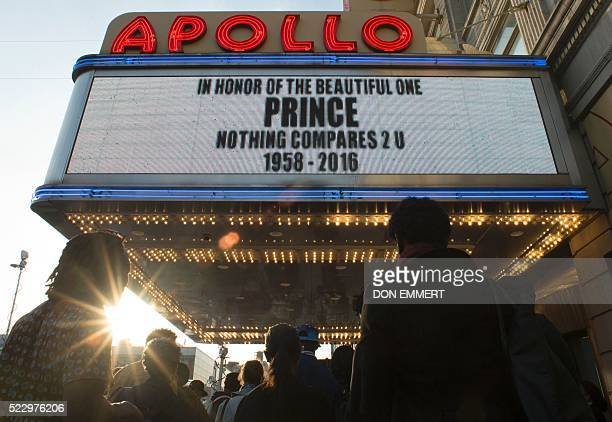TOPSHOT People gather outside the Apollo Theater to listen to music by Prince April 21 2016 in New York Emergency personnel tried and failed to...