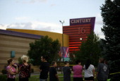 People gather outside the Century 16 movie theatre July 23 2012 in Aurora Colorado Twentyfouryearold James Holmes is suspected of killing 12 and...