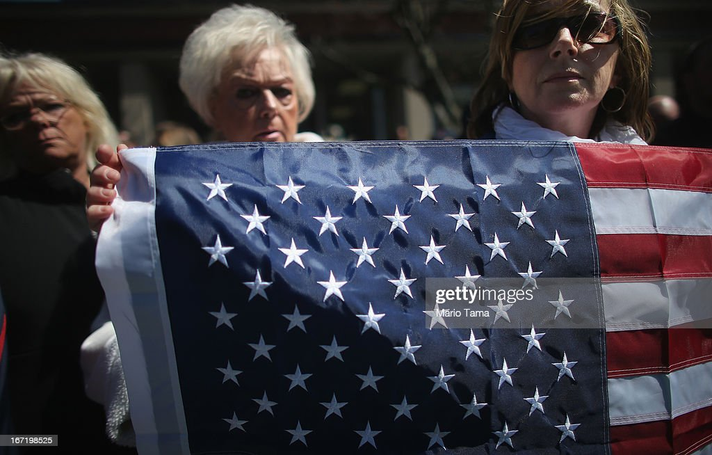 People gather outside the funeral for 29-year-old Krystle Campbell, who was one of three people killed in the Boston Marathon bombings, on April 22, 2013 in Medford, Massachusetts. The 29-year-old restaurant manager was raised in Medford. Massachusetts Gov. Deval Patrick has asked residents to observe a moment of silence at the time of the first explosion at 2:50 p.m. this afternoon.