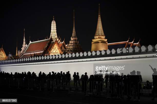 People gather outside the Grand Palace to pay their respects to Thailand's late King Bhumibol Adulyadej as the city prepares for his cremation on...
