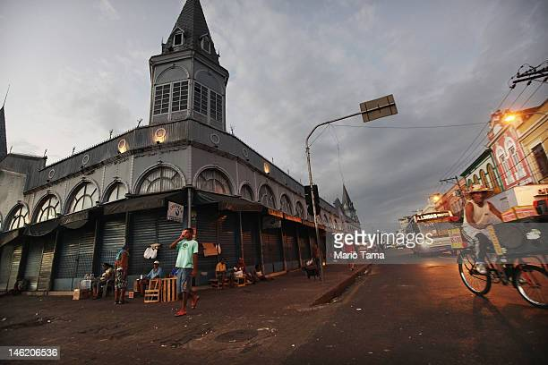 People gather outside the historic VeroPeso market on June 6 2012 in Belem Brazil Belem is considered the entrance gate to the Amazon and for more...
