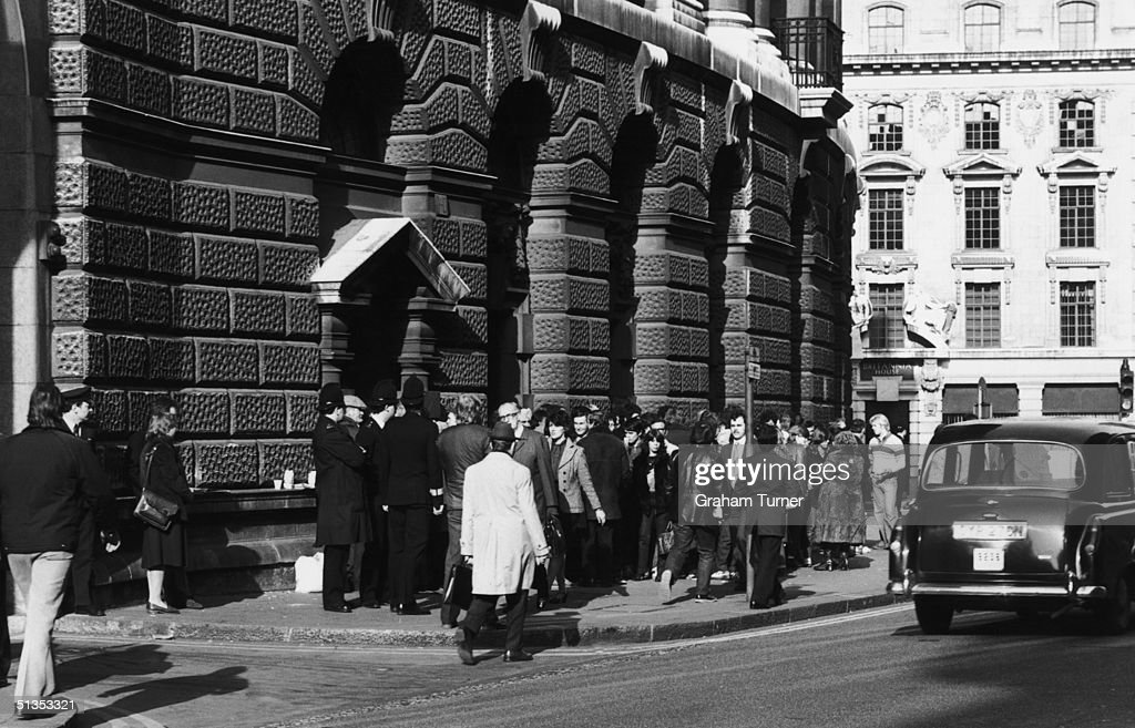 People gather outside the Old Bailey in London, during the murder trial of Peter Sutcliffe, aka 'The Yorkshire Ripper', 5th May 1981. Sutcliffe was found guilty of thirteen counts of murder, and sentenced to life imprisonment.