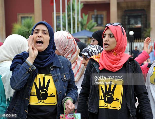 People gather outside the parliament building during a protest to condemn mass death sentence decision in Egypt on May 19 2015 in Rabat Morocco On...