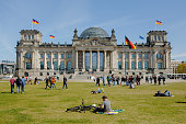 People gather outside the Reichstag on April 20 2014 in Berlin Germany The Reichstag home of the Bundestag the German parliament is among the city's...