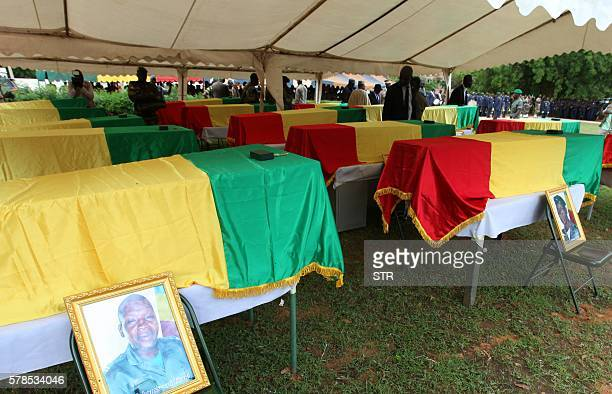 People gather stand coffins of soldiers killed in an attack on their base in Mali on July 21 2016 in Segou Mali announced on July 21 it had opened an...