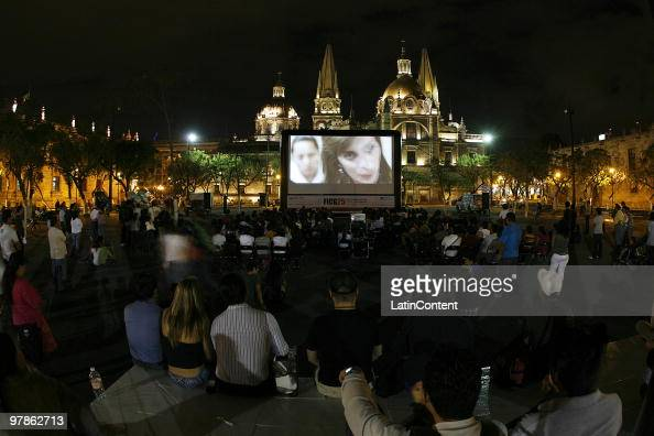 People gather to a special openair screening as part of the 25th Guadalajara International Film Festival at the Plaza de la Liberacion on March 18...