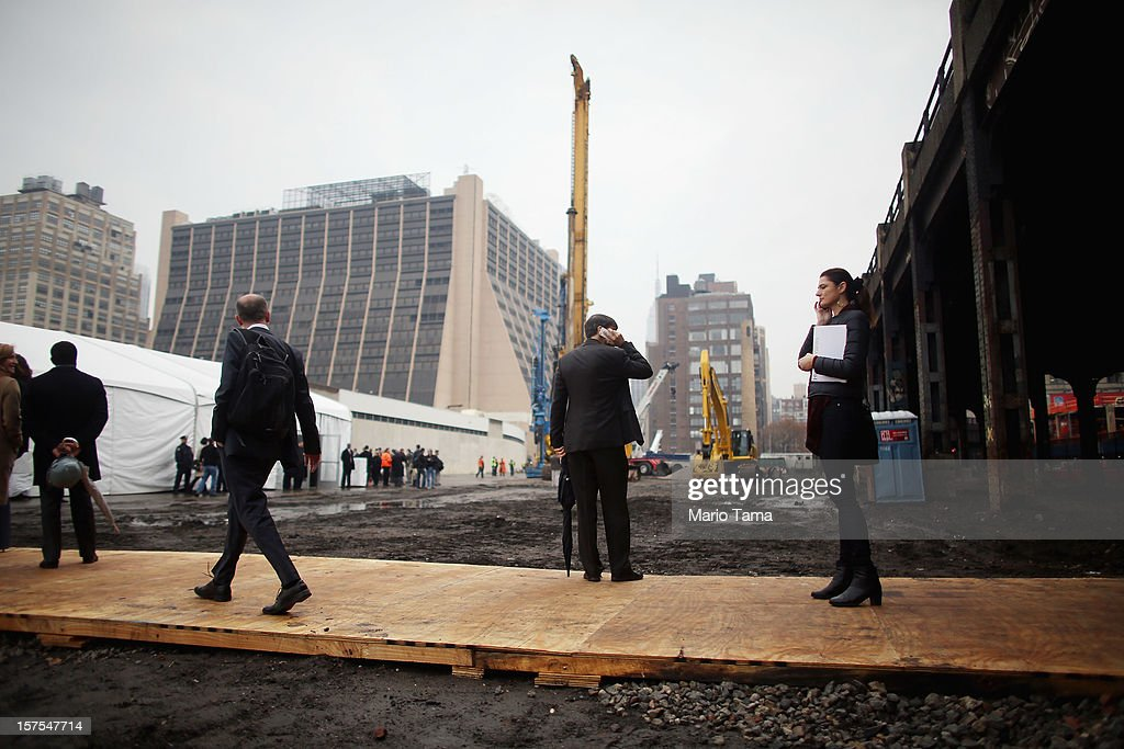 People gather to attend a groundbreaking ceremony for the Hudson Yards development which is expected to boast 13 million square feet of residential and commercial space on a 26-acre site on Manhattan's west side on December 4, 2012 in New York City. The site was the largest undeveloped piece of property in Manhattan and is expected to create around 23,000 construction jobs. It will be the largest private development in the city since Rockefeller Center.