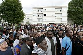 People gather to attend a white march organised in tribute to Adama Traore in BeaumontsurOise on July 22 2016 Violence erupted in the northern...