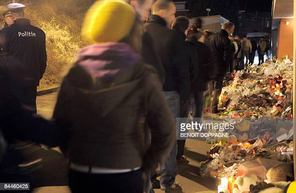 People gather to commemorate the victims of a knife attack at a Belgian creche last week in Dendermonde on January 26 2009 In an attack that shocked...