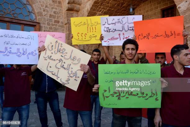 People gather to condemn Assad regime forces' suspected chemical gas attack in the oppositionheld Syrian province of Idlib town in Tripoli Libya on...