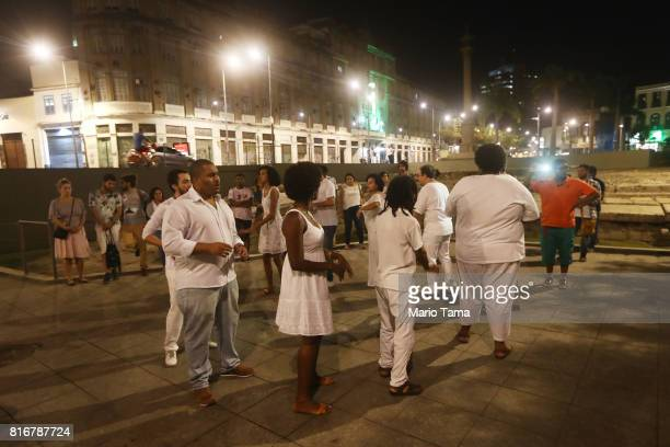 People gather to dance to AfroBrazilian music at the Valongo slave wharf entry point in the Americas for nearly one million African slaves on July 17...