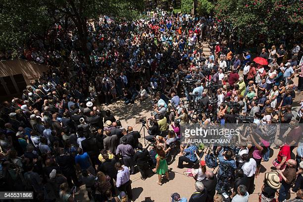 People gather to hold a faith vigil at ThanksGiving Square in Dallas Texas on July 8 following the shootings during a peaceful protest on July 7...