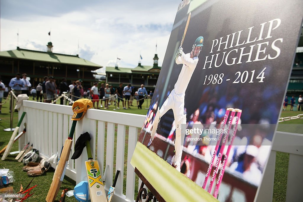 People gather to lay flowers and messages at the Randwick End of the SCG following the gathering of people to watch the funeral service held in Macksville for Australian cricketer <a gi-track='captionPersonalityLinkClicked' href=/galleries/search?phrase=Phillip+Hughes+-+Cricketer&family=editorial&specificpeople=757530 ng-click='$event.stopPropagation()'>Phillip Hughes</a> at the Sydney Cricket Ground on December 3, 2014 in Sydney, Australia. Australian cricketer <a gi-track='captionPersonalityLinkClicked' href=/galleries/search?phrase=Phillip+Hughes+-+Cricketer&family=editorial&specificpeople=757530 ng-click='$event.stopPropagation()'>Phillip Hughes</a> passed away last Thursday, aged 25, as a result of head injuries sustained during the Sheffield Shield match between South Australia and New South Wales at the SCG on Tuesday 25th November.