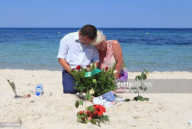 People gather to lay flowers on beach where 39 people were killed on 26th of June 2015 in a terrorist attack in Souuse Tunisia on June 28 2015 At...
