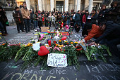People gather to leave tributes at the Place de la Bourse following today's attacks on March 22 2016 in Brussels Belgium At least 31 people are...