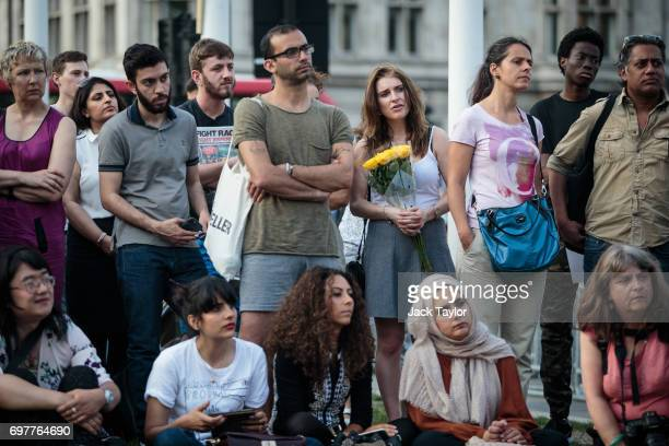 People gather to listen to a speaker during a vigil for the victims of the Grenfell Fire disaster at Parliament Square on June 19 2017 in London...