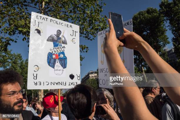 People gather to listen to La France Insoumise leftist party's leader delivering a speech on Place de la Republique on July 3 2017 in Paris in...